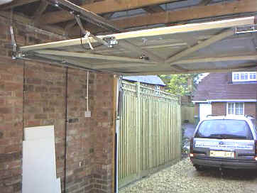 A completed conversion with a Seip electric operator fitted - the door now glides effortlessly back into the garage on its new horizontal ... & Re-hanging Cardale a vertically tracked door