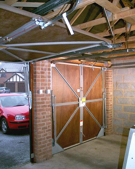 Soft rubber weather-strips down the timber door jambs keep out draughts whilst eliminating any risk of damage to your car & Upgrading a Garador Mk3c vertically tracked canopy door