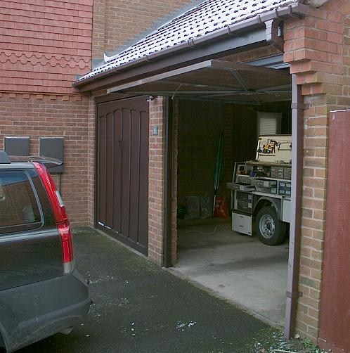 Upgrading a garador mk3c vertically tracked canopy door for Drive through garage door