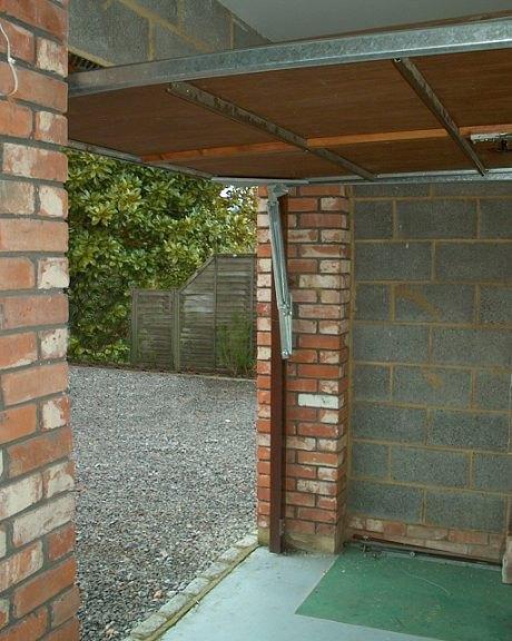 henderson garage doorUpgrading a Henderson vertically tracked canopy door