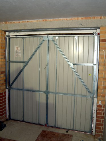 Re Hanging A Vertically Tracked King Garage Door
