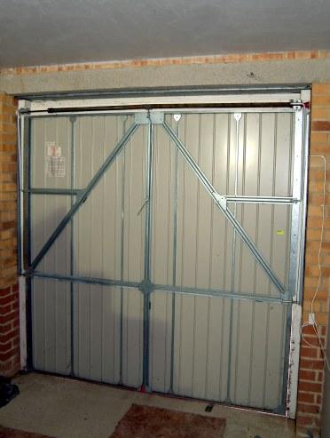 Re-hanging a vertically tracked King garage door