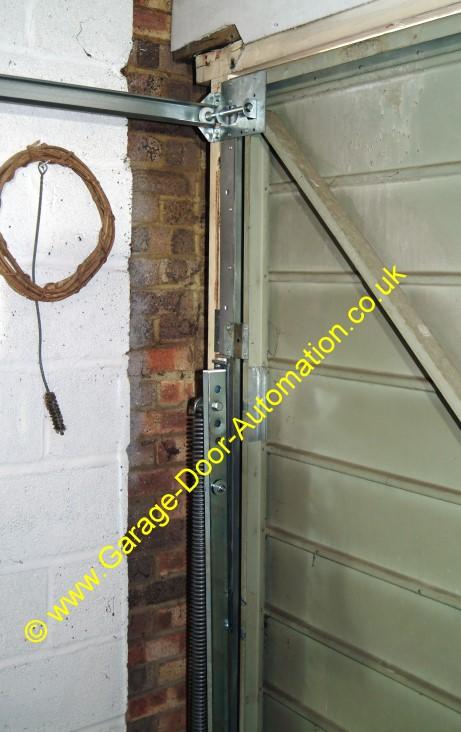 Re hanging a double width vertically tracked door for Garage door horizontal track