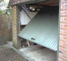 Inward turning one piece garage door for 1 piece garage door